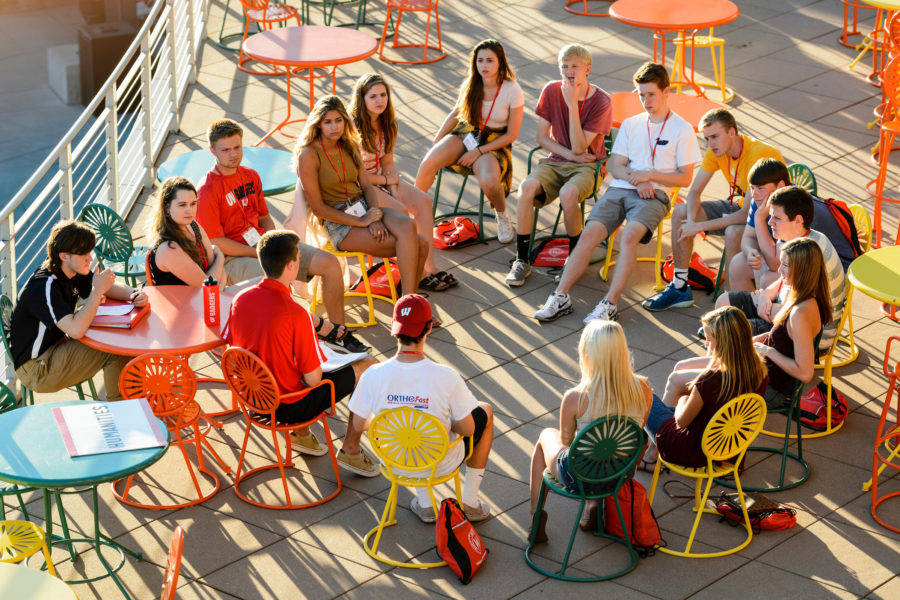 A new-student leader talks with incoming first-year undergraduates about the challenges new students may face as they transition to campus life and facilitates a small-group discussion during in a Student Orientation, Advising and Registration (SOAR) session outdoors at Union South's The Plaza at the University of Wisconsin-Madison on June 20, 2016. Sponsored by the Center for the First-Year Experience, the two-day SOAR sessions provide new students and their parents and guests an opportunity to meet with staff and advisors, register for classes, stay in a residence hall, take a campus tour and learn about campus resources. (Photo by Jeff Miller/UW-Madison)